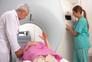 Senior woman undergoing CT test scan