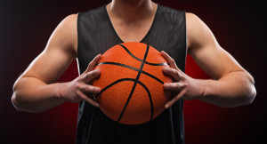 Close up of male basketball athlete gripping the ball