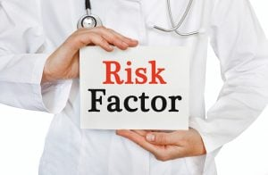 Risk Factor card in hands of Medical Doctor