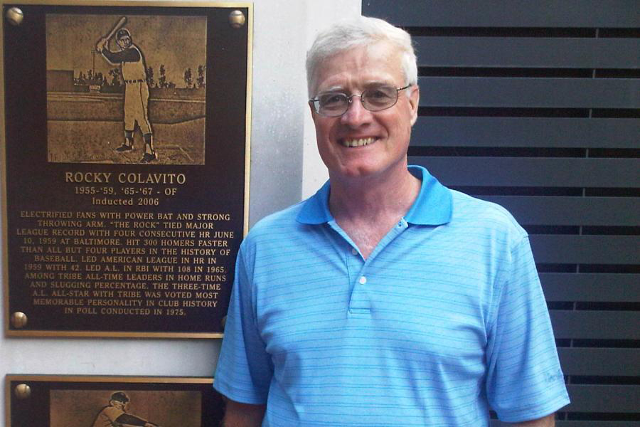 Jim Flanagan in front of plaque