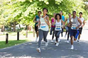 Group,Of,Marathon,Athletes,Running,On,Street